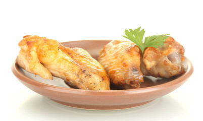 roasted chicken wings with parsley in the plate isolated