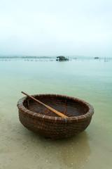 fishing basket on the river bank