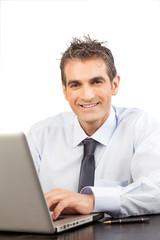 Businessman Using Laptop at Work