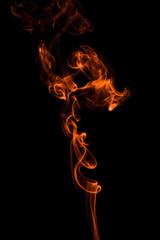 Abstract orange smoke-like shape on black background