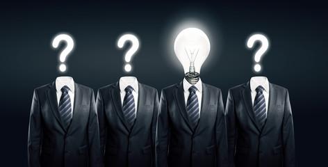 Businesssman with idea standind between other businessmen