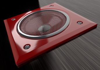 red speaker on background