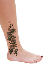 henna being applied to leg
