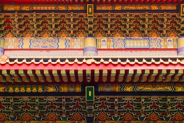 Beautiful buddhistic artwork on the roof of a temple
