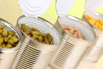 Open tin cans of peas, corn, bean and french bean