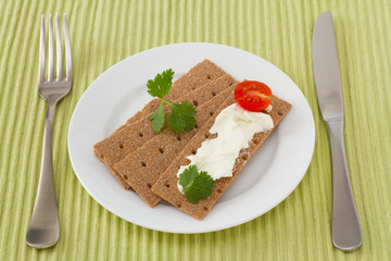 toasts with cream cheese and tomato