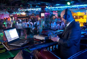 DJ behind the control panel