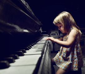 girl playing on an  piano.