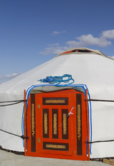 White ger with red ornate door, Mongolia