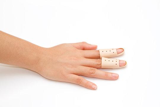 Broken Finger in a splint on white background
