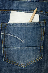 Jeans textile pocket with a paper note without the text, looking