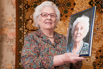 Senior woman shows her portrait