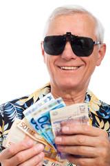 Happy rich elderly man with money