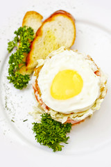 Salad with egg and toasts