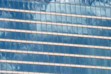 Glass wall of modern office building facade closeup
