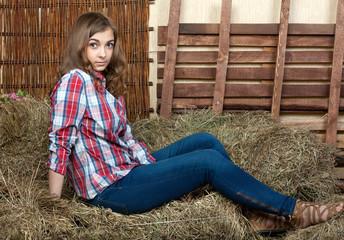 Beautiful girl in the hay
