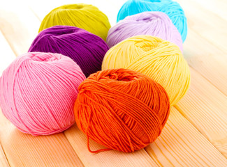 Knitting yarn on wooden background