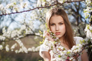beautiful girl in the branches