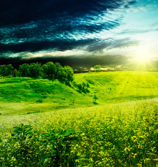 Dramatic evening over the summer meadow, natural backgrounds