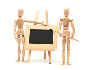 Wooden artist mannequin with brush in pose with wood frame