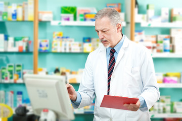 Pharmacist looking at the computer