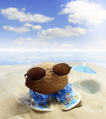 Coconut at beach with glasses and sandals fun concept