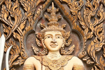 carving Wood at Door of Thailand's Temple