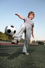 happy boy play in soccer
