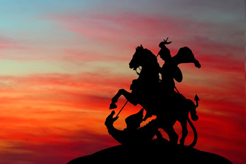 Wall Murals Dragons Saint George and the Dragon on sunset background