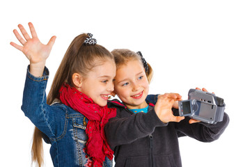 Two young girls with a camera