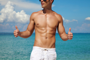 Thumbs up for a beach body