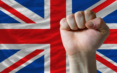 Hard fist in front of britain flag symbolizing power