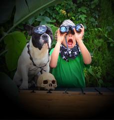 Explorer boy with binoculars