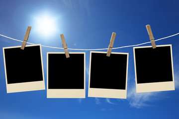 Photos frames hanging in the rope on a sky
