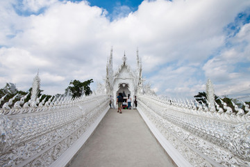 White church in Wat Rong Kuhn reflection, northern Thailand