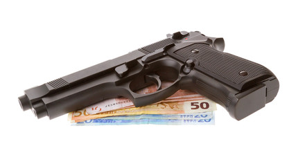 Semi-automatic gun with some euro bills isolated