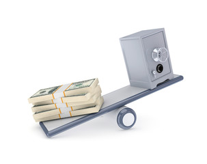 Dollar packs and iron safe on a scales.