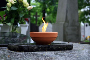 candle burning on cemetery