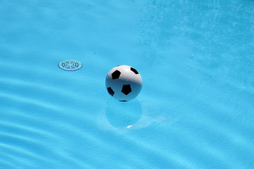 Soccer ball in the pool