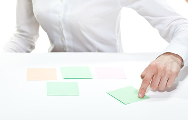Woman's hand pointing at paper note