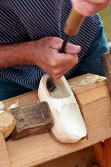 Farmer demonstrating the making of Dutch wooden clogs