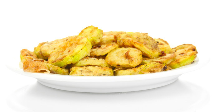 Fried zucchini in a white plate isolated on white