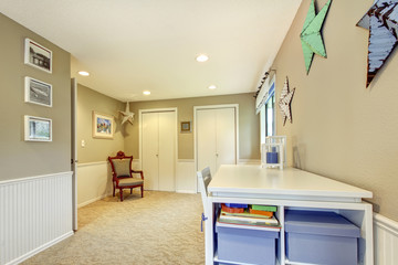 Home craft room in interior with beige and white and carpet.