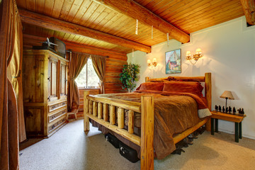 Cowboy bedroom interior with wood ceiling.