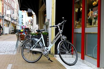 Bike is parked near  shop in Gorinchem. Netherlands