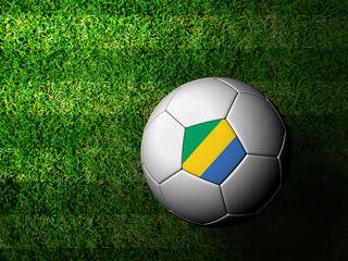 Gabon Flag Pattern 3d rendering of a soccer ball in green grass