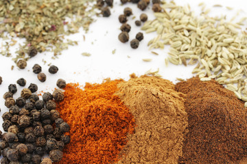 Piles of various herbs and spices