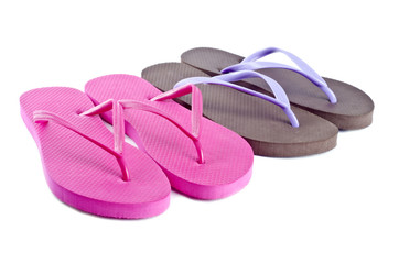 Two Pairs of Flip Flops Isolated on White