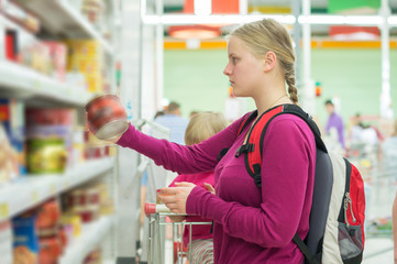 Mother and daughter shopping in sweets section in supermarket