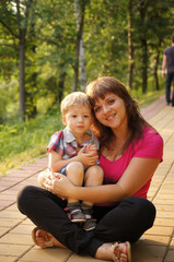 The little boy with mum on walk